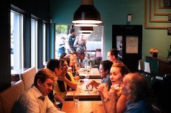photo of people at a restaurant